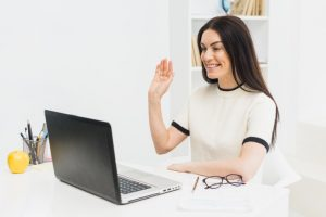 woman participating in virtual team meeting activity