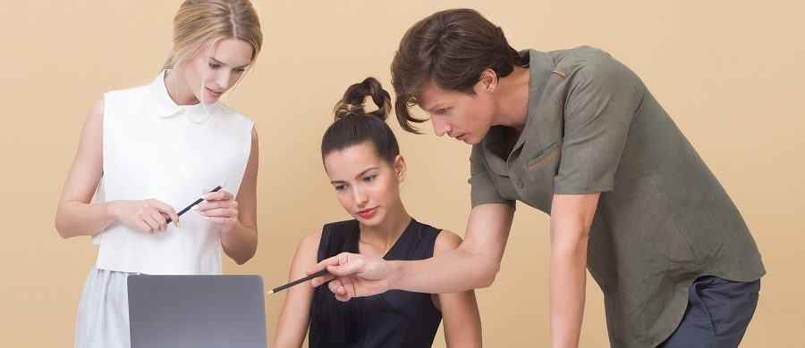 Man and Two Women Looking On the Laptop Screen
