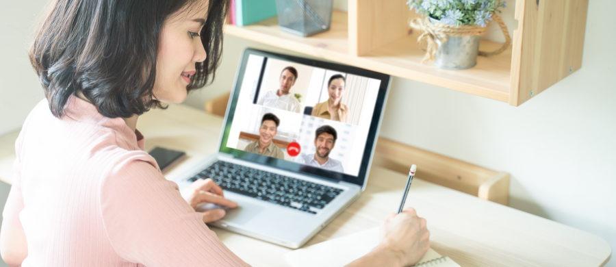 Woman attending virtual meeting